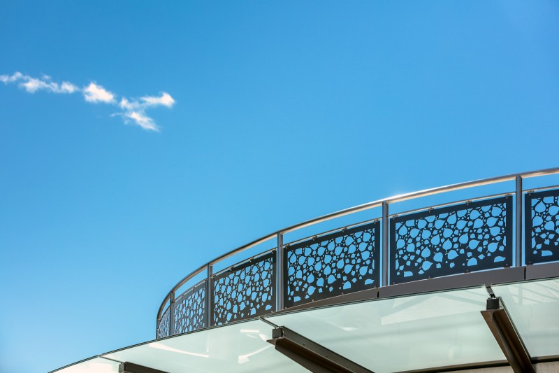 Curved Stainless Steel Laser Cut Railing With Blue Sky Background