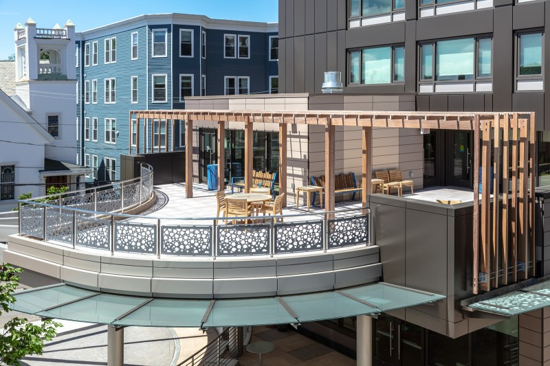 Drone Shot of Curved Laser Cut Railing on Apartment Patio