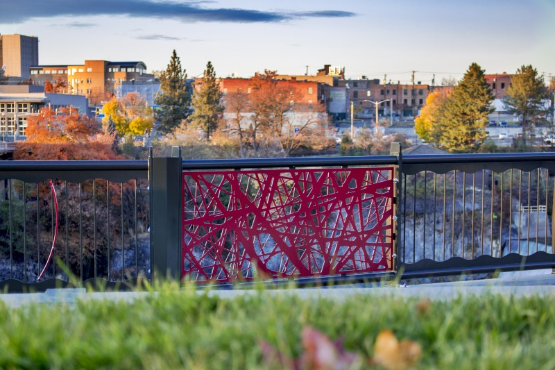 Red Nest Pattern Railing Panel in Park Overlooking City