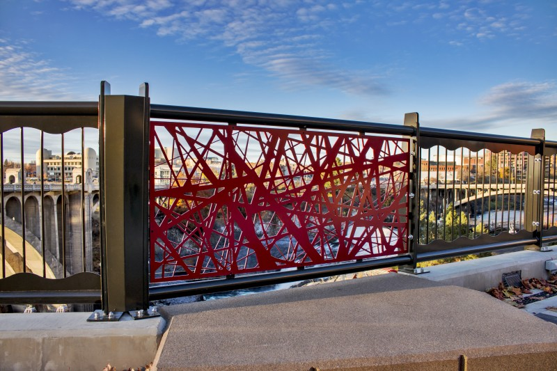 Close of Red Nest Pattern Accent Railing Panel with Bridge in Background