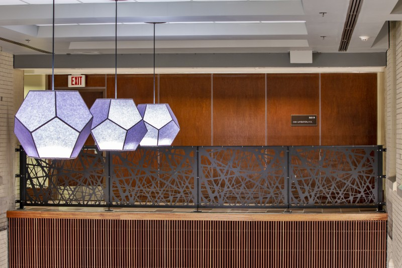 Nest Pattern Mezzanine Railing and Purple Hexagon Lights Above First Floor Lobby